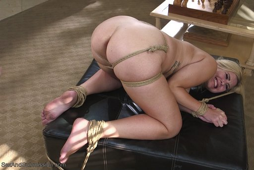 bent over in rope bondage ready for anal sex with tommy pistol