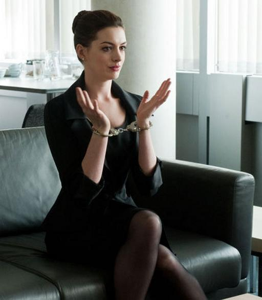 handcuffed catwoman Anne Hathaway
