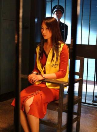 pretty asian woman handcuffed and locked in steel restraint chair in a jail