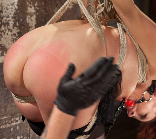 spanking her tied-up butt