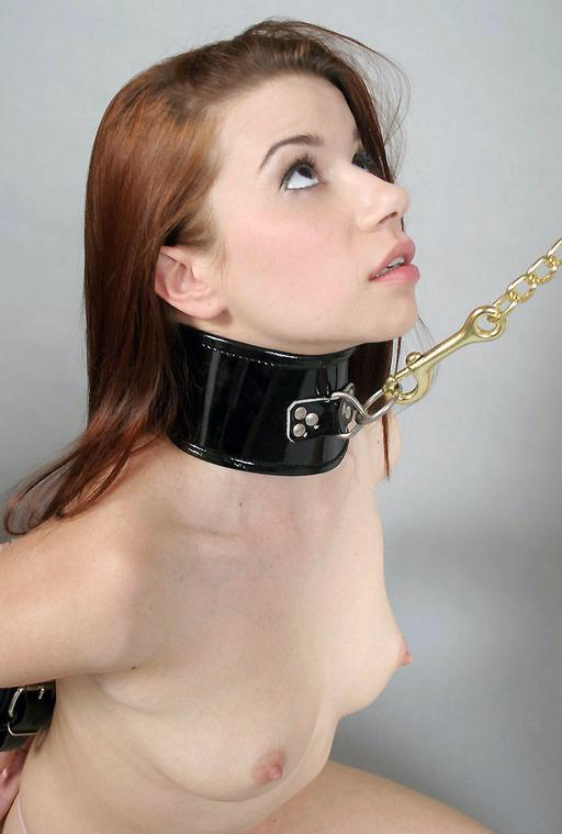 good slave girl in collar on a gold leash