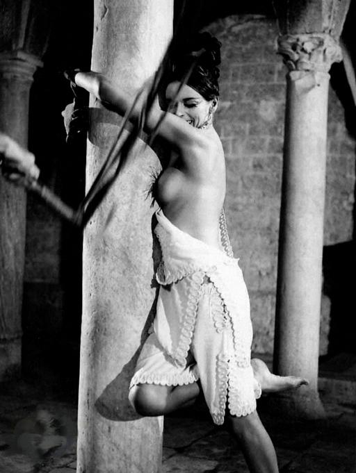 Barbara Steele tied to a stone column and whipped in the movies