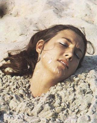 bondage in the beach sand