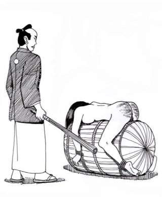 japanese girl over a barrel for a beating with a bundle of rods