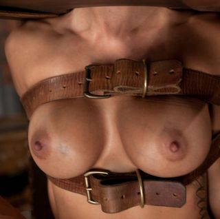 boobs bound with old leather belts