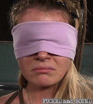 Anita Blue blindfolded and looking sad