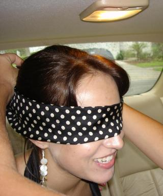 bride in blindfold on way to bachelorette party