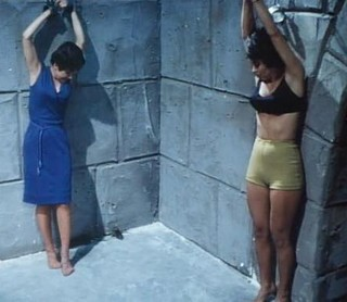 two girls in chains in the vampire dungeon