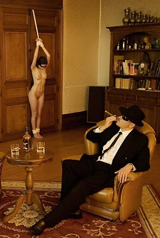 symbolic cigar and a woman in bondage
