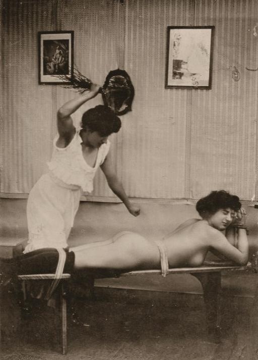 strapped down to the spanking bench for a bondage birching