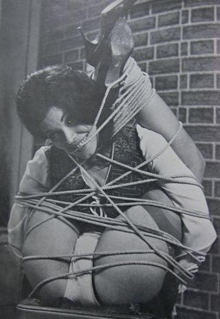 cute sweater girl in lots of rope bondage
