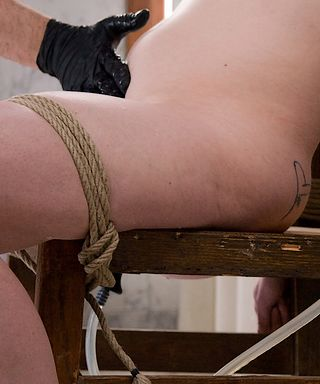 Carmen Stark getting an enema in the bondage chair