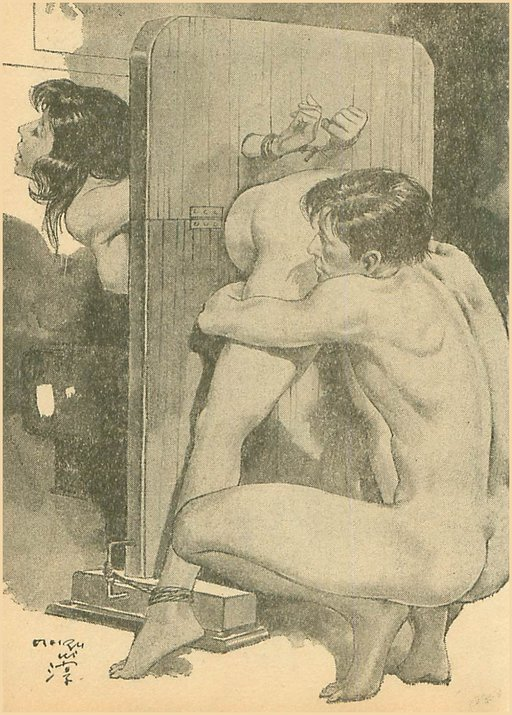 woman in stocks is hugged from behind before her bondage pussy licking