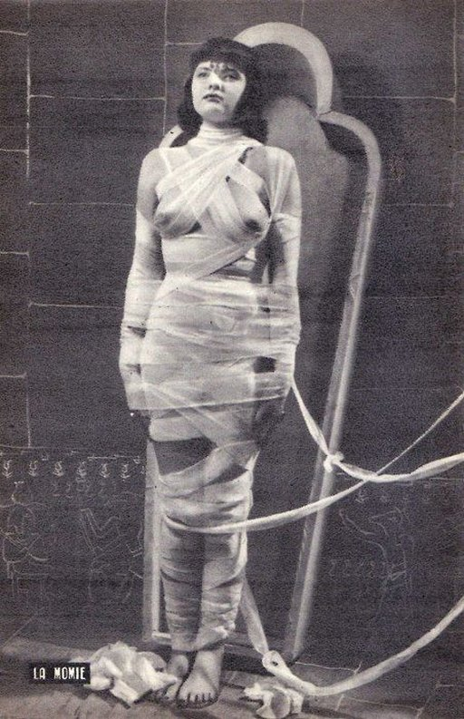 Bondage mummy is very alive, but wrapped in restraining bandages and ready to go into the tomb!