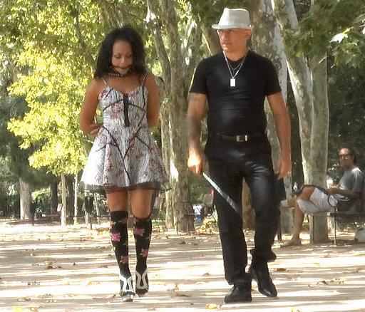 a bondage stroll through a park in a spanish city