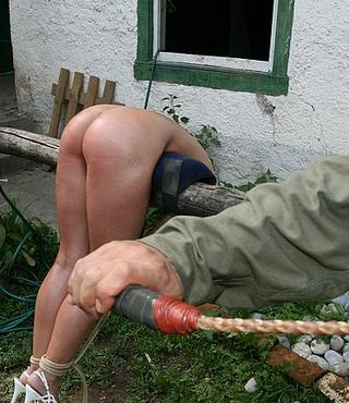 bondage girl being whipped