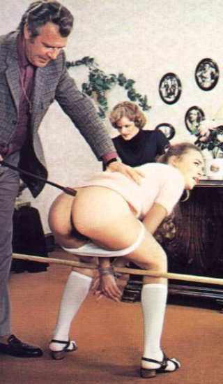 schoolgirl spanked in a broom handle bondage tie