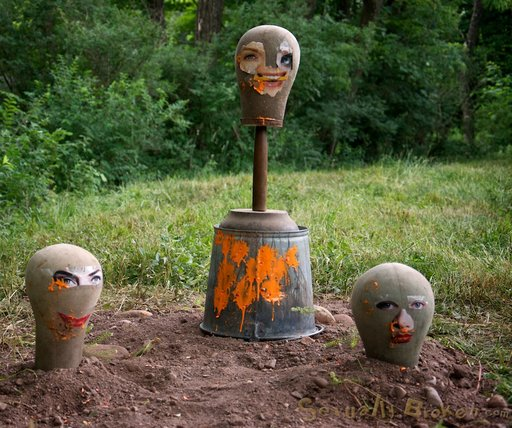 creepy manequins and a bucket concealing the head of a buried Allie James