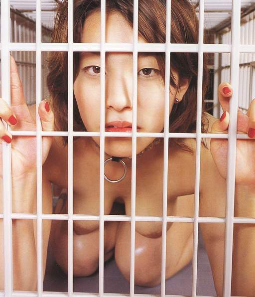 collared asian slavegirl in a white metal cage