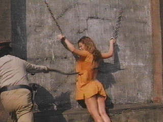 female prisoner chained and getting a prison whipping