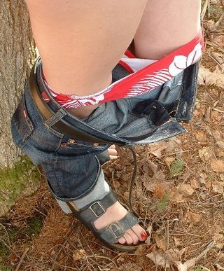 panties down and handcuffed to a tree