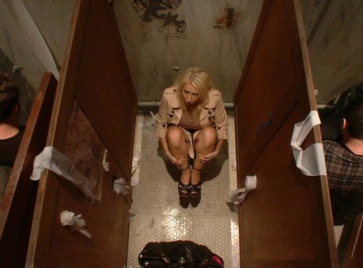 Candy Manson hovering nervously in the men\'s bathroom at the rough biker bar