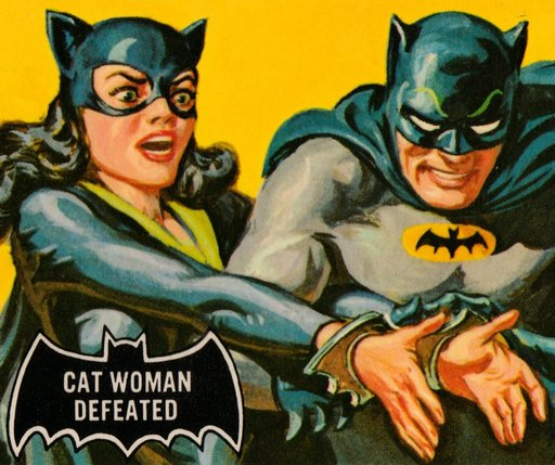 cat woman handcuffed by batman and wearing the bat cuffs