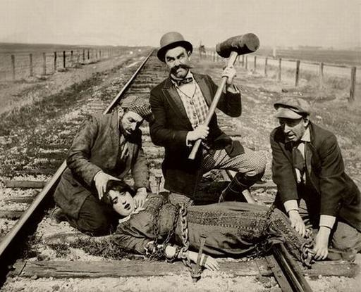 chained to the railroad tracks