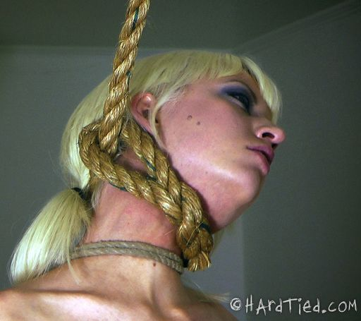 Cherry Torn with her lovely neck in a noose