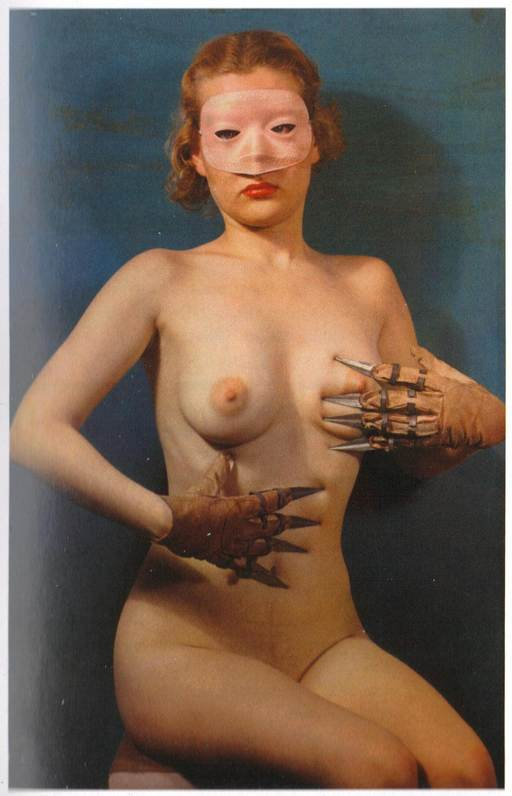 woman with claw gloves