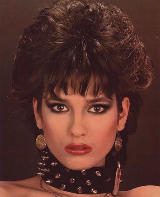 collared 80s chick with big hair from lots of hairspray