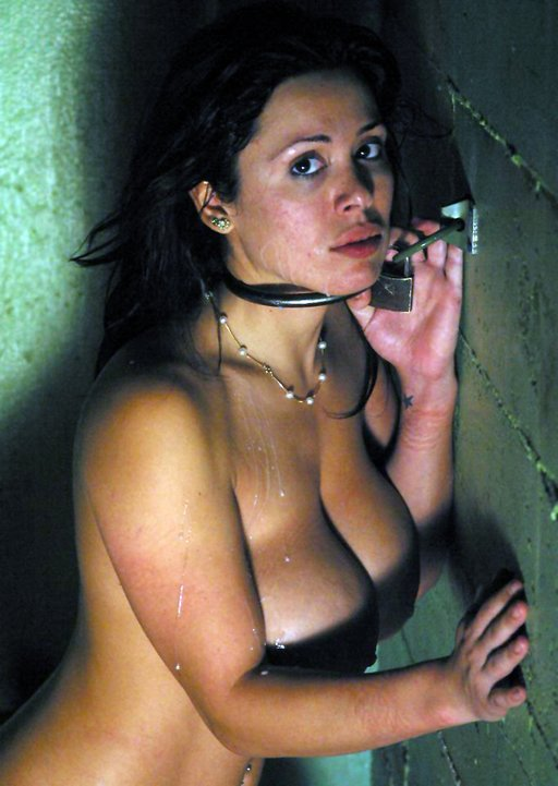 Sienna West chained to the wall with a steel shackle