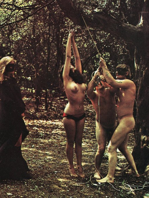 creepy cultists tie up a naked woman in the woods