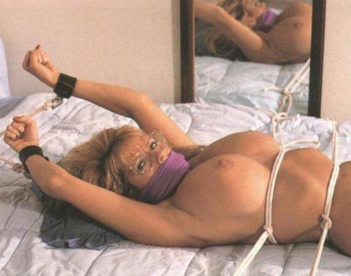 darla crane in glasses, cuffs, and bondage rope