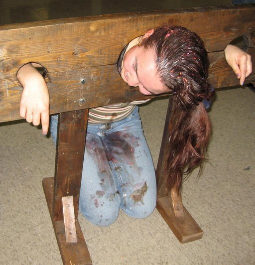 filthy girl in kneeling pillory