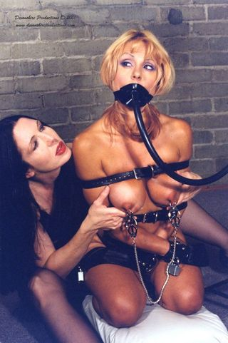 bondage girl with a hose in her mouth