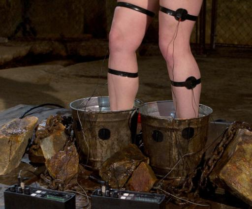 two electrified buckets of water for giving forced electric orgasms to a reluctant bondage electroslut