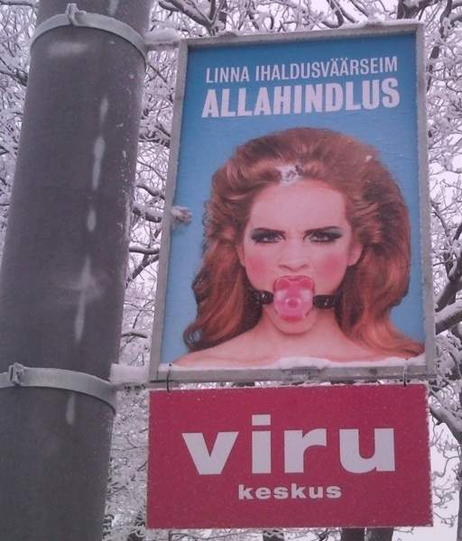 billboard bondage in estonia -- gagged woman