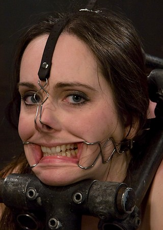 face tied in bondage with nose hook