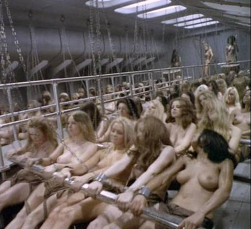 nude women chained to the oars and laboring under the whip