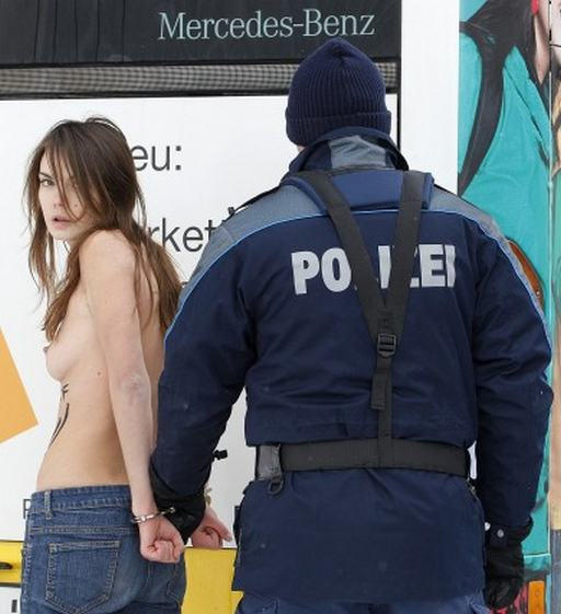 handcuffed petulant beauty arrested after topless protest