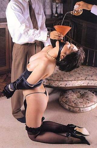 Japanese slave girl force fed through a funnel