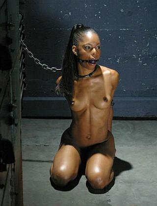 marie luv kneeling in her bondage chains
