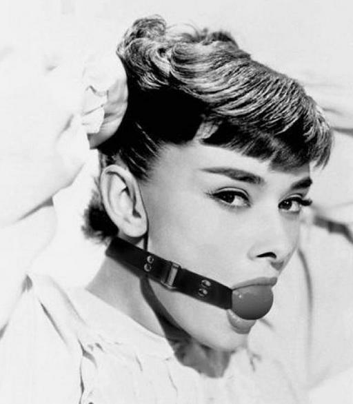 Audrey Hepburn wearing a ball gag