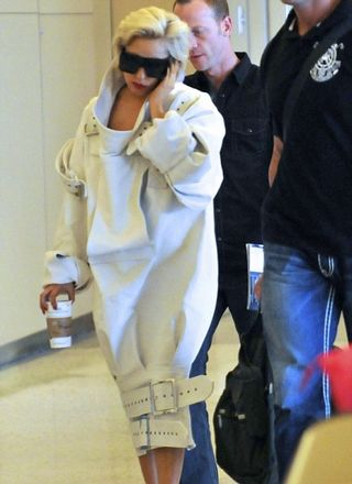 Lady Gaga in a strait-jacket at the airport
