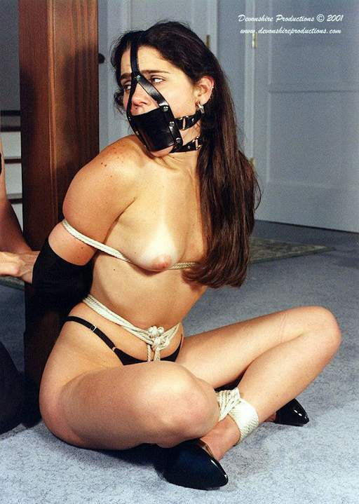 tied to a post and well gagged