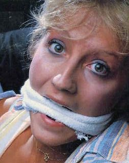 gagged with a strip of torn towel