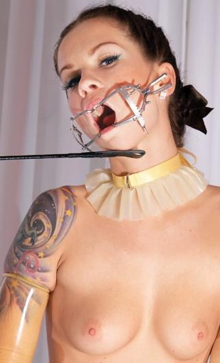 latex girl with an open-mouth gag