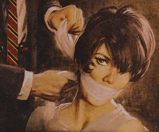 pulp cover: pretty spy silenced with a fetching cloth gag