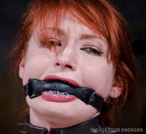 violet monroe drooling and blowing spit bubbles past her padded rubber bit gag